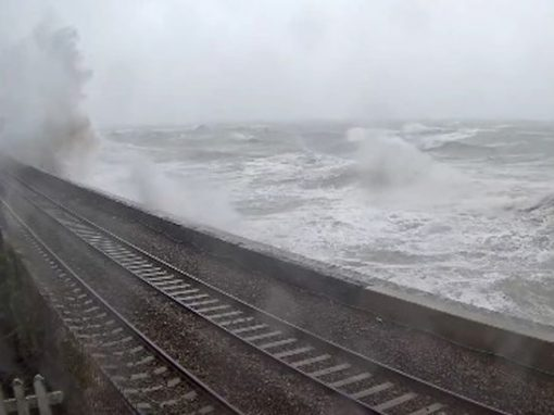 Mirror – Storm Frank: Train battered by giant waves along new